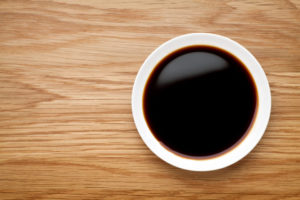 A bowl of soy sauce