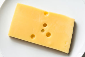 A slice of tilsit cheese