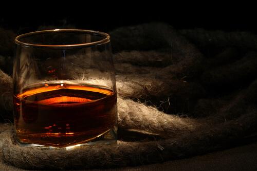 A glass of dark rum