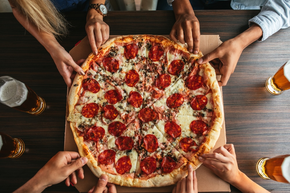 People sharing pizza